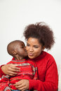Black boy kissing his mother Royalty Free Stock Photo