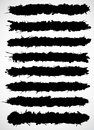 Black brush strokes made of ink splatter. Royalty Free Stock Photo