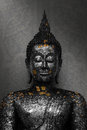 Black the Buddha Statue with gold leaf Royalty Free Stock Photo
