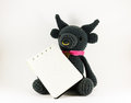 Black buffalo doll and notebook on white background isolated. Royalty Free Stock Photo