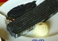 Black cake served with vanilla icecream ball Royalty Free Stock Photo