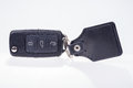 Black car key with remote central locking and pendant Royalty Free Stock Photo