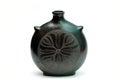Black ceramic homemade vase over white background Stock Photo