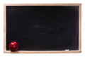 Black chalkboard with chalk piece and red apple isolated on white Royalty Free Stock Photos