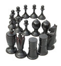 Black chesses lined up as s on white Royalty Free Stock Photos