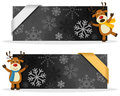 Black christmas banners with reindeer two a cute cartoon smiling and greeting snowflakes and a ribbon eps file available Stock Images