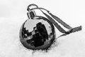 Black Christmas decoration ball isolated on a white background. Royalty Free Stock Photo