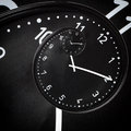 Black clock clasic in the drost effect Royalty Free Stock Photos
