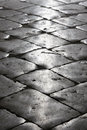 Black cobblestone street Stock Images