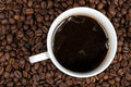 Black coffee on beans Royalty Free Stock Images