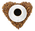 Black coffee beans as a heart and cup Royalty Free Stock Photography