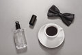 Black coffee with a bow tie and eau de toilette Royalty Free Stock Photo