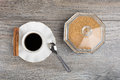 Black coffee and brown sugar bowl on wooden background Royalty Free Stock Photos