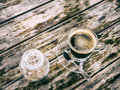 Black coffee in with cane sugar glass cup Royalty Free Stock Photos