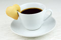Black coffee with cookie cup of heart shaped Royalty Free Stock Image