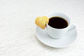 Black coffee with cookie cup of heart shaped Stock Image