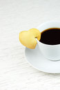 Black coffee with cookie cup of heart shaped Royalty Free Stock Photography