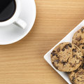 Black coffee with cookie in top view over table Stock Images