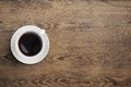 Black coffee cup on old wooden table top view Royalty Free Stock Photo