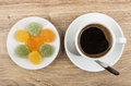 Black coffee in cup, spoon and marmalade in saucer Royalty Free Stock Photo