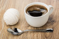 Black coffee in cup, white marshmallow and spoon on table Royalty Free Stock Photo