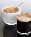 Black coffee and froth in glass mug with sugar Stock Images