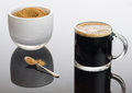 Black coffee and froth in glass mug with sugar Royalty Free Stock Photo