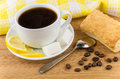 Black coffee, lemon and sugar, flaky biscuits on bamboo table Royalty Free Stock Photo