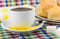Black coffee, lemon and sugar, flaky biscuits close up Royalty Free Stock Photo