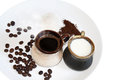 Black coffee with milk and sugar wilk ingredients on a white plate Royalty Free Stock Photography