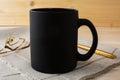 Black coffee mug mockup with glasses and pen Royalty Free Stock Photo