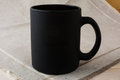 Black coffee mug mockup on the linen napkin Royalty Free Stock Photo