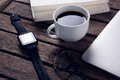 Black coffee with organizer, laptop, spectacles and smart watch on wooden table Royalty Free Stock Photo