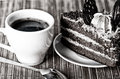 Black coffee, a slice of cake and a teaspoon Royalty Free Stock Image