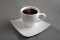 Black coffee in a white cup Stock Photos