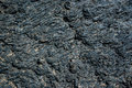 Black cold lava textured background in Lanzarote, Canary Islands Spain Royalty Free Stock Photo