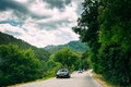 Black colour Audi car on background of French mountain nature landscape Royalty Free Stock Photo