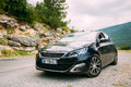 Black colour Peugeot 308 car on background of French mountain Royalty Free Stock Photo