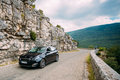 Black colour Peugeot 308 car on background of French mountain na Royalty Free Stock Photo
