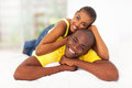 Black couple bed cheerful young lying in Royalty Free Stock Photos