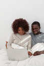 Black couple in love using the computer young Royalty Free Stock Photography