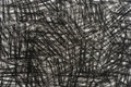 Black crayon doodles background texture