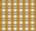 Black crowns on golden columns pattern