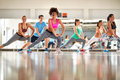 Black curly trainer with group training aerobic Royalty Free Stock Photo
