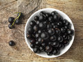 Black currant background in a white bowl Stock Image