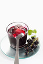 Black currant jam in glass, spoon and black currants Royalty Free Stock Photo