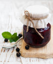 Black currants jam on a old wooden background Royalty Free Stock Photos