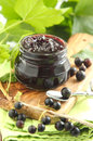 Black current jam in jar Royalty Free Stock Images