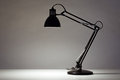 Black desk lamp on white background Royalty Free Stock Images