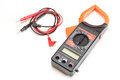 Black digital clamp meter isolated with red and cables Stock Image